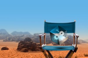 blue cinema chair with a transparent cube. In a background, a desert landscape.